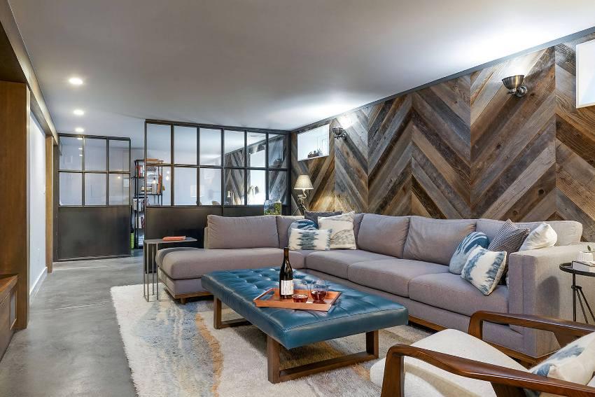 В современных дизайн-проектах часто можно встретить нейтральную палитру в оформлении пола гостиных