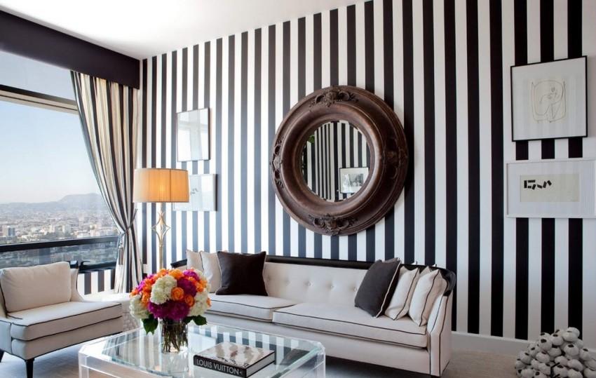 В интерьере современной гостиной чаще выделяют отдельные поверхности с помощью фактуры или принта