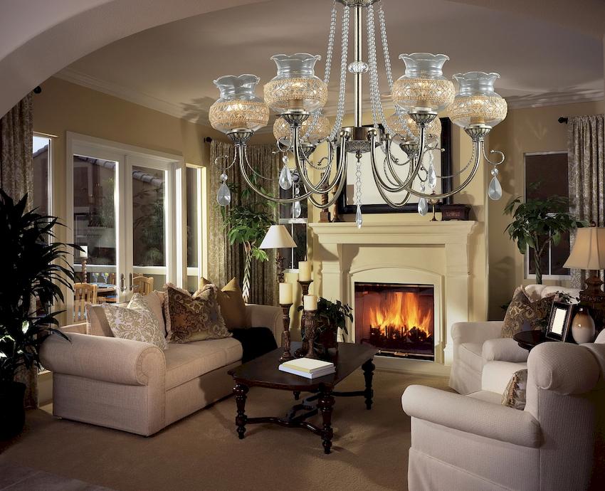 В просторных гостиных люстра может применяться для зонирования комнаты