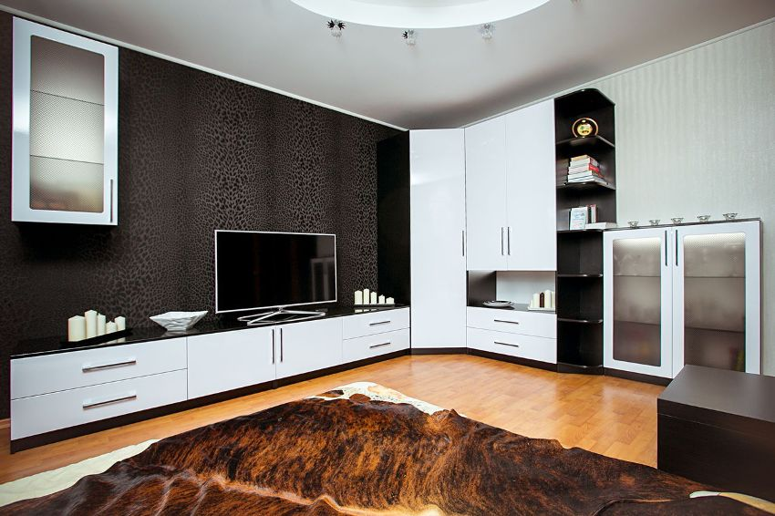 Стенку-горку в гостиную можно выполнить в любом стилевом направлении